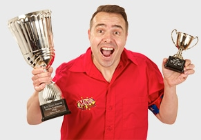 Silly Scott with trophy for childrens entertainer of the year